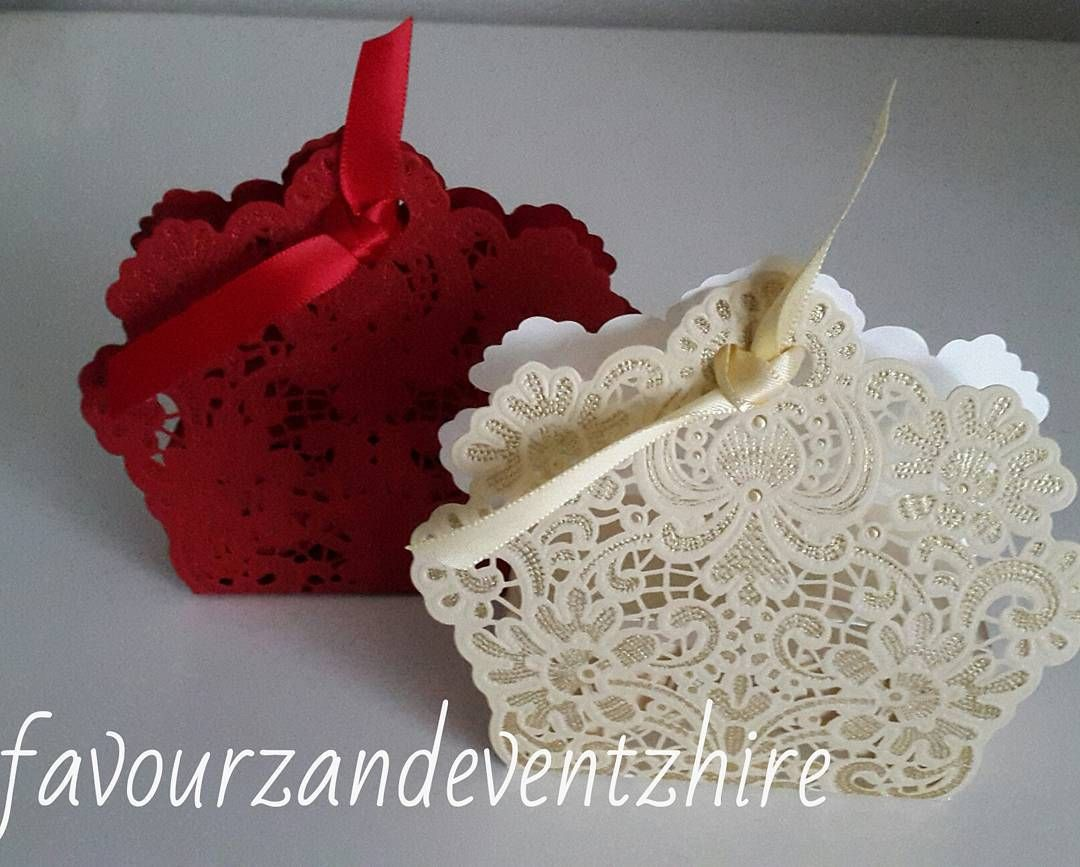 Laser cut favour boxes in either red or champagne gold each made