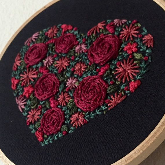 Floral embroidery on black fabric in the shape of by MoonriseWhims