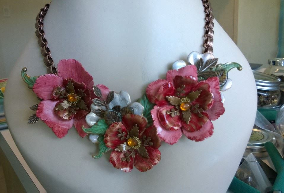 Hand colorized brass flower necklace created by Renee Webb Allen of Small Stuff Design