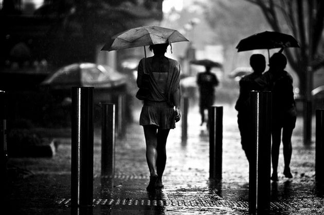 People Walking In The Rain