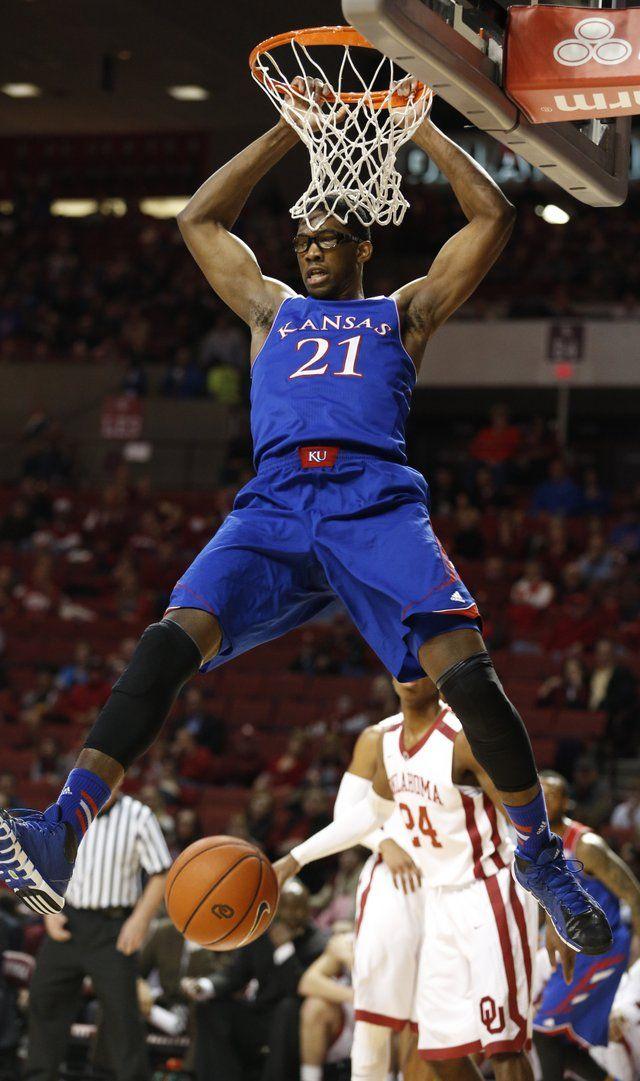 Kansas center Joel Embiid turns for a shot around Texas