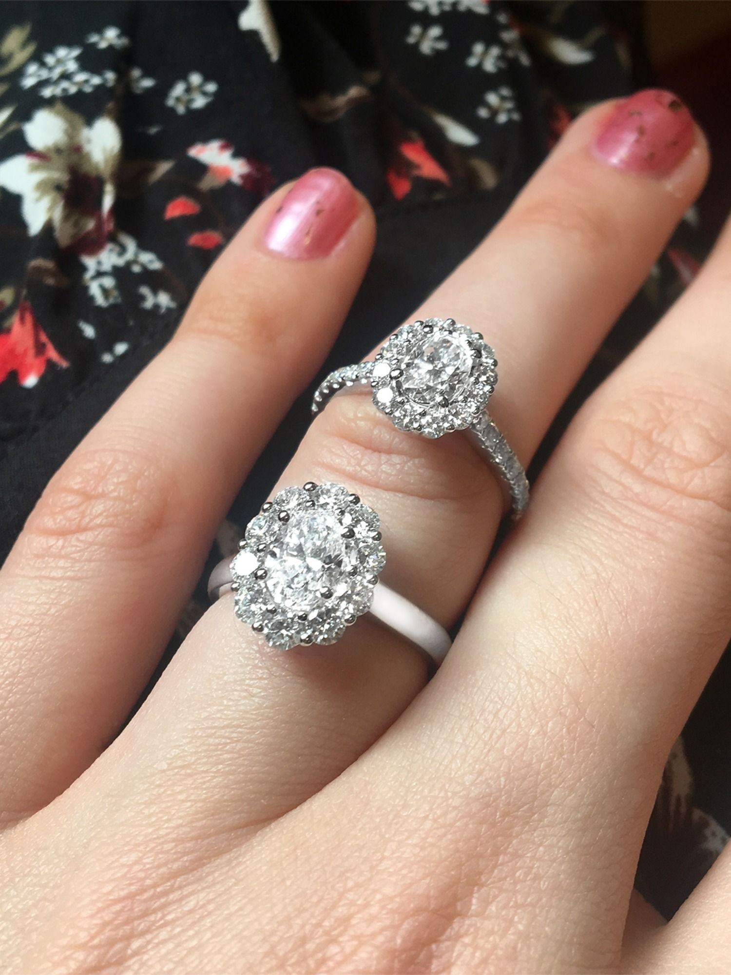 A stunning pair of diamond halo rings. The top ring is 1