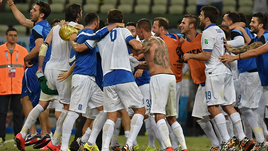 Greece celebrate after qualifying for the last 16 with a 90th minute Georgios Samaras penalty.