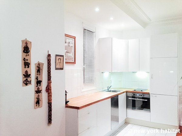 An all white kitchen in this #Paris vacation rental http://www ...