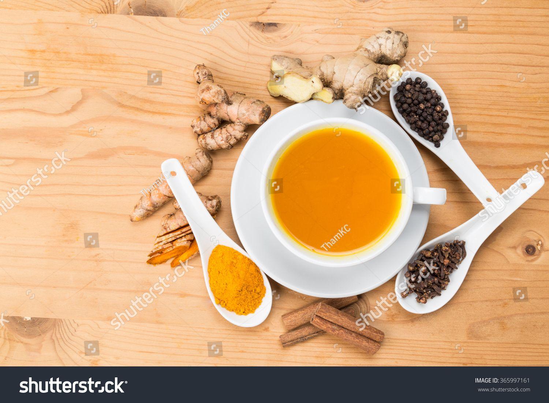 Aromatic turmeric tea with black pepper cinnamon cloves