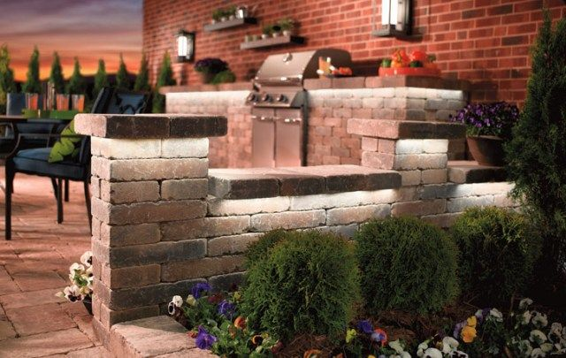 Led lights under coping stones of low garden wall dream home outdoor hardscape lighting on a patio mozeypictures Image collections