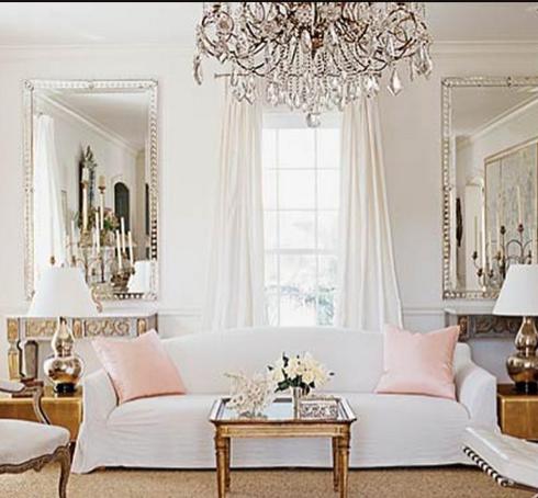 Christian Liaigre sofa and coral silk pillows