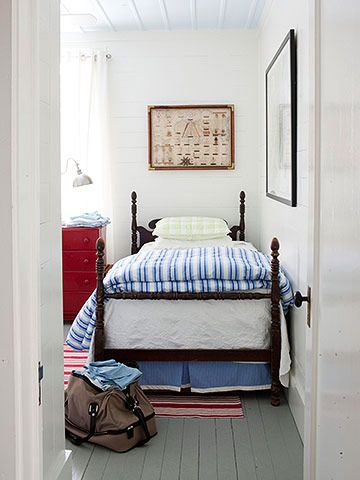 Clean, simple, fresh, inviting! Painted wood floors, white walls, white drapes, striped red rug, etc. make this space so welcoming! Has a very coastal feel to it! Pinned from BHG.