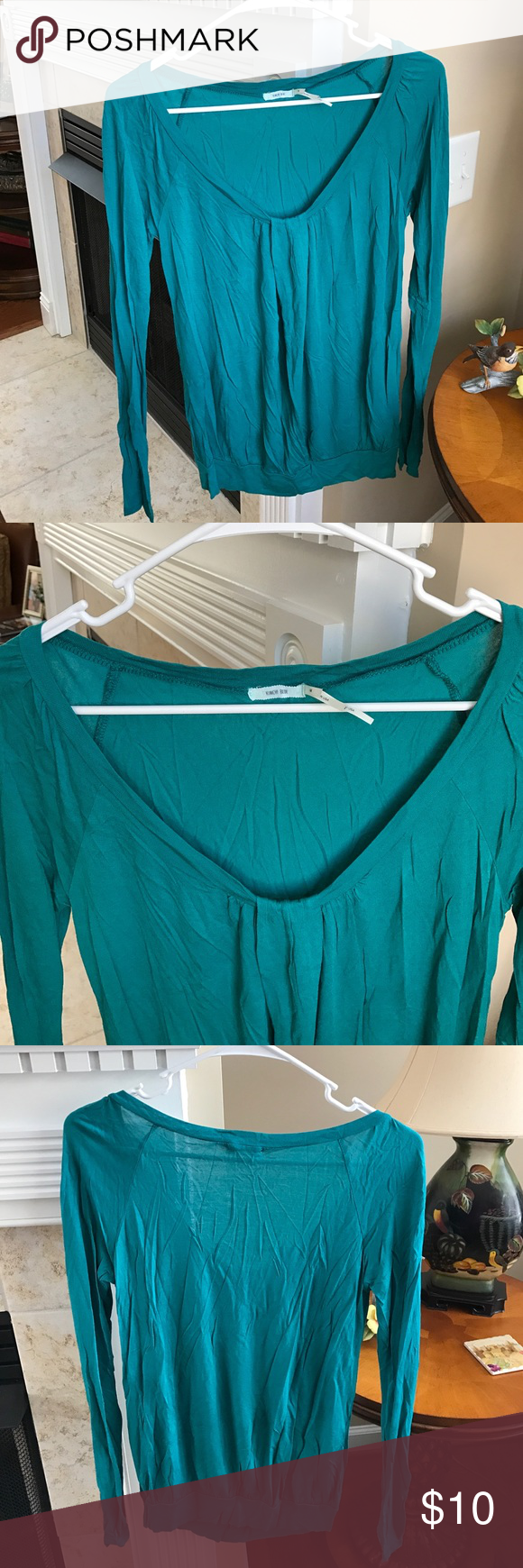 Urban Outfitters Teal Long Sleeve Top Urban Outfitters Teal Long Sleeve Top by Kimchi Blue. Size M. Great Used Condition . Kimchi Blue Tops Tees - Long Sleeve