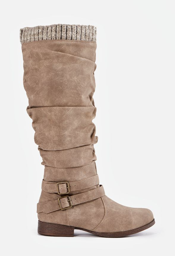 A slouchy tall boot with a sweater cuff detail and an inner zip closure. Perfect for breezy fall days....