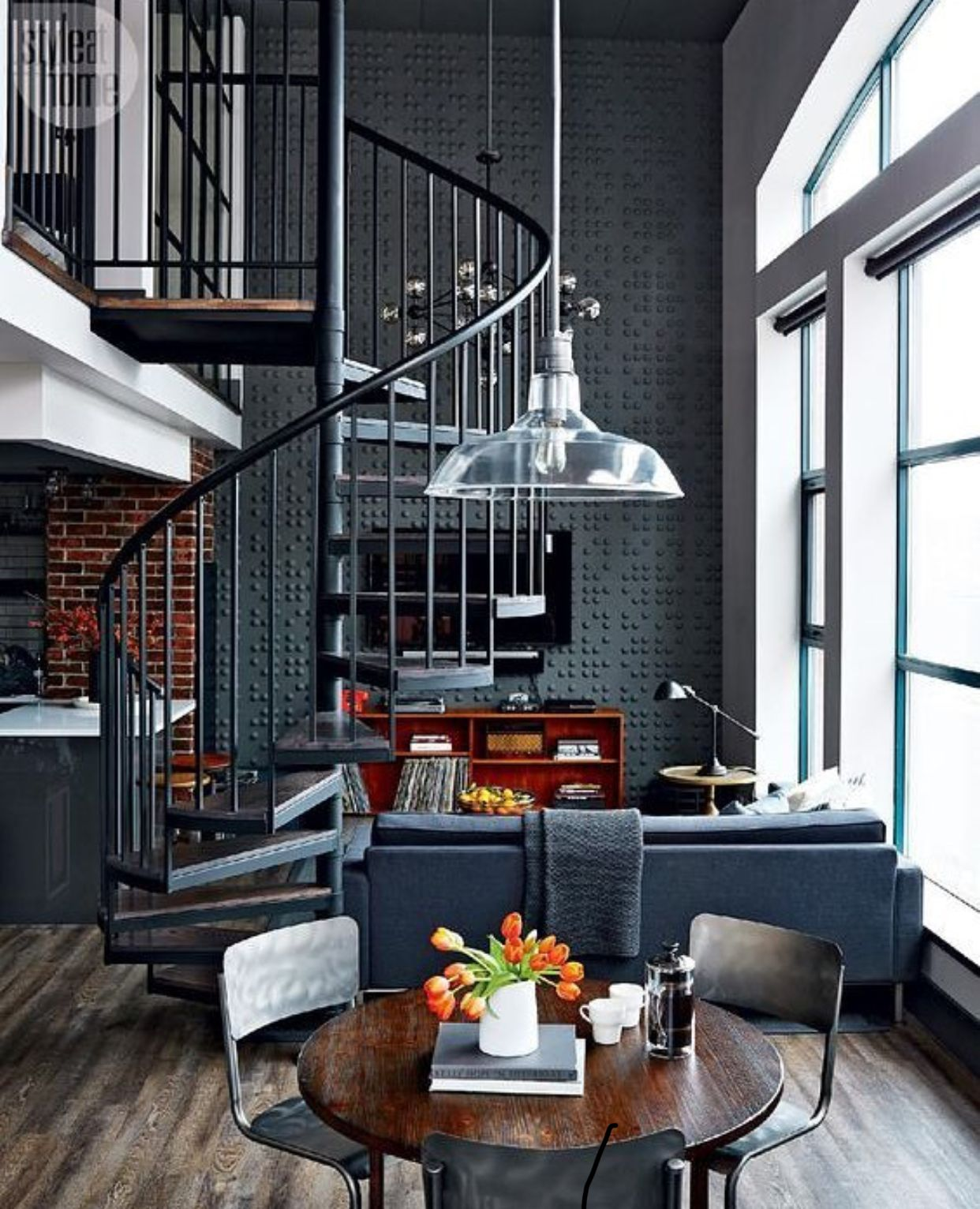 dark brick and tile loft space with