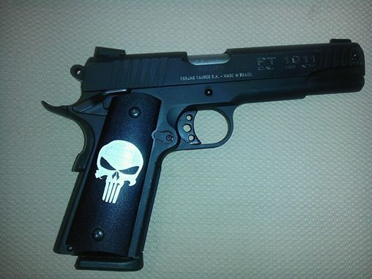 My new Taurus PT 1911 45 Automatic with my new Punisher hand grips