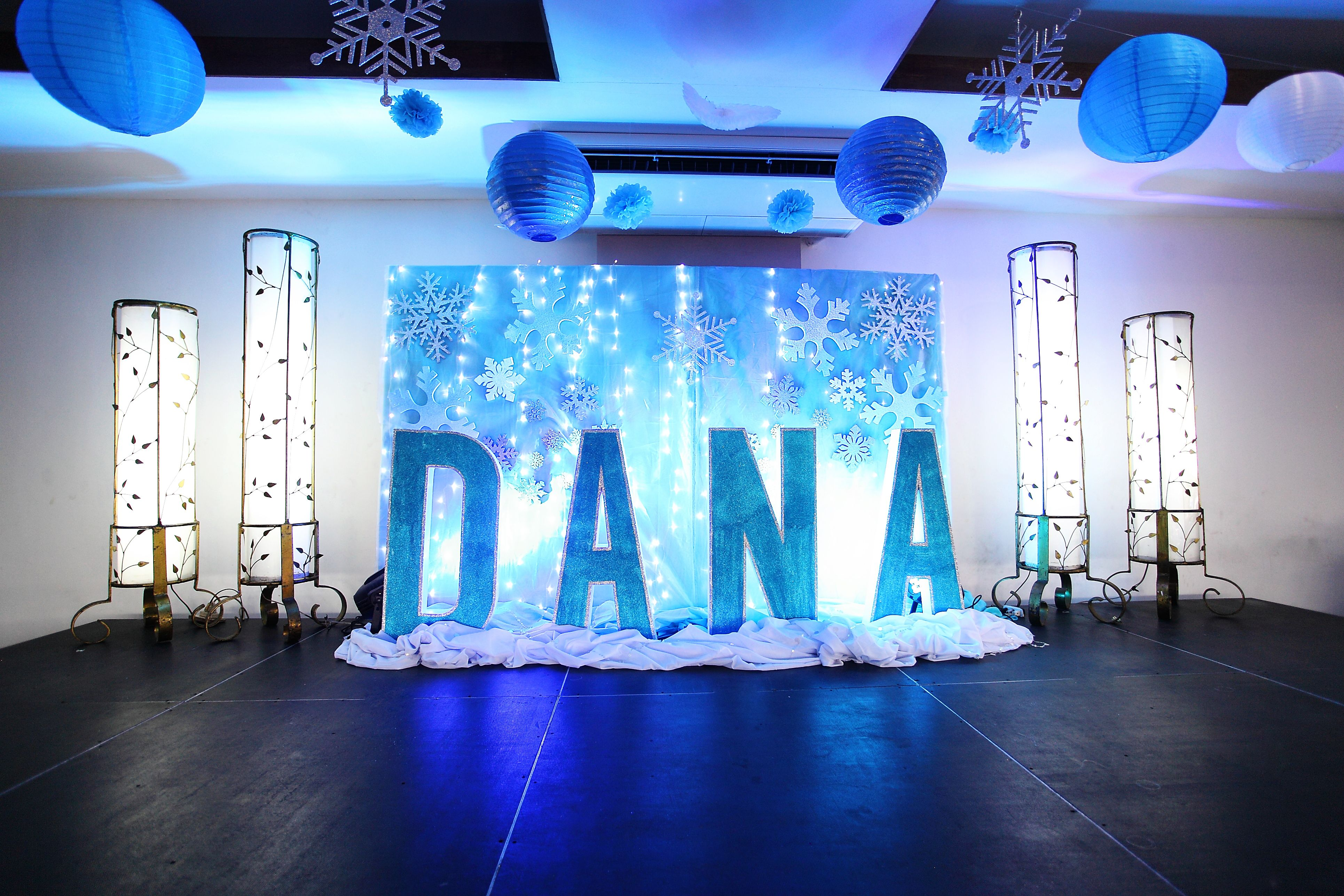 Winterthemed stage design Letter standees with a snowflakesfilled