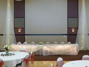 Ivory Table Drape with Icicle Lights at Brooklyn Park Community Center by Deckci Decor