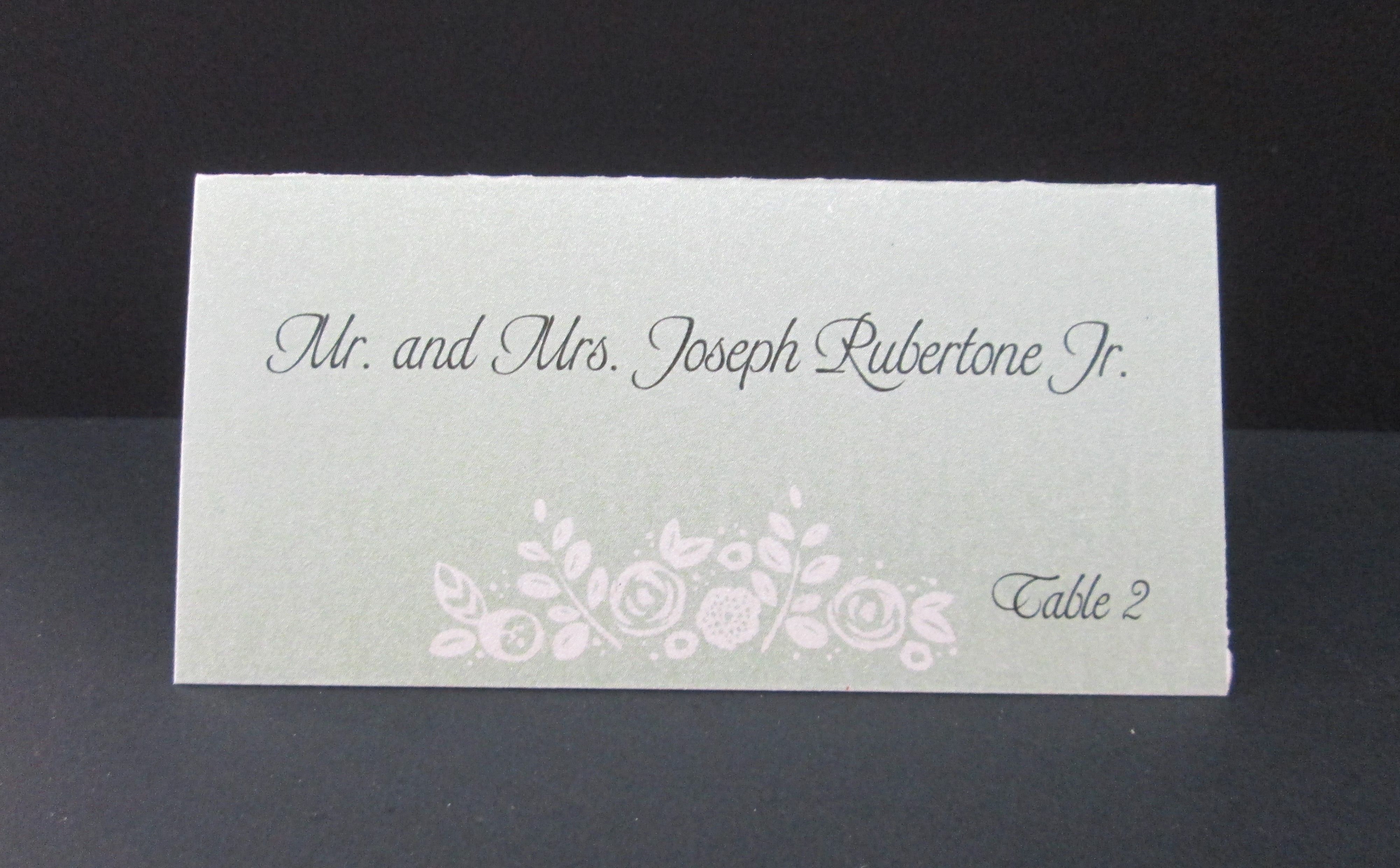 Green place card with flower design place card holders