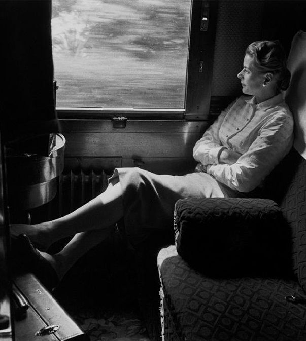Ingrid Bergman on the train from Rome to the Cannes Film Festival (1956)  Photographer: David Seymour