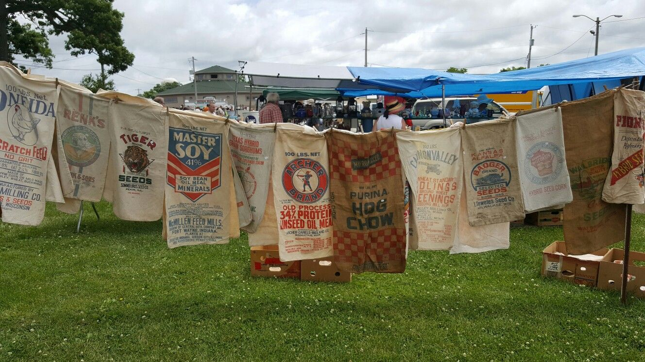 A collection of vintage grain sacks at the flea market is waiting for your ideas to repurpose!