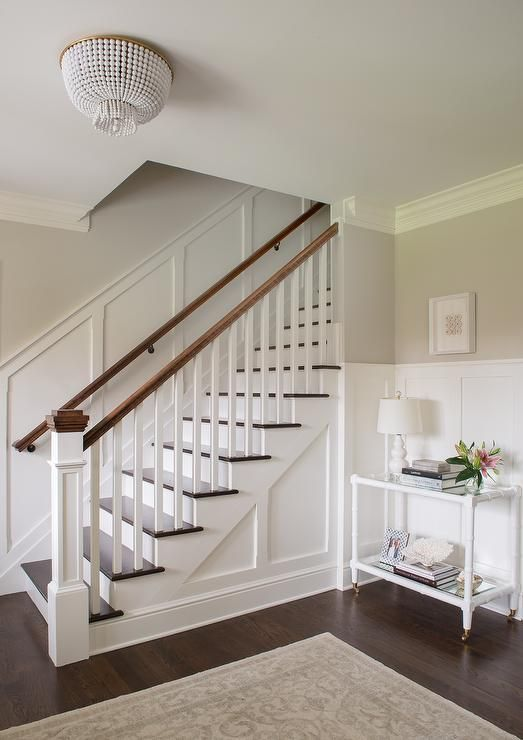 White and gray entry boasts upper walls painted soft gray ...