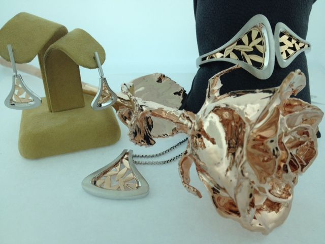 Sterling silver and rose gold set with 24kt rose gold dipped rose. #jrfoxjewelers