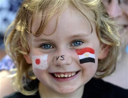 "A girl is seen with a Japanese flag and an Egyptian flag painted on her face as she attends the men""s quarterfinal soccer match between Japan and Egypt at the London 2012 Olympic Games at Old Trafford in Manchester, August 4, 2012."