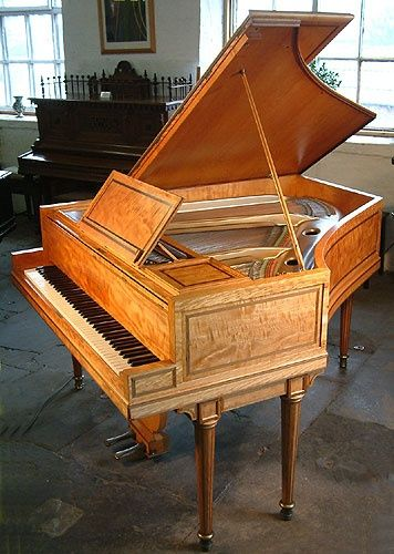 A Regency style, art cased Broadwood grand piano with a polished, satinwood case