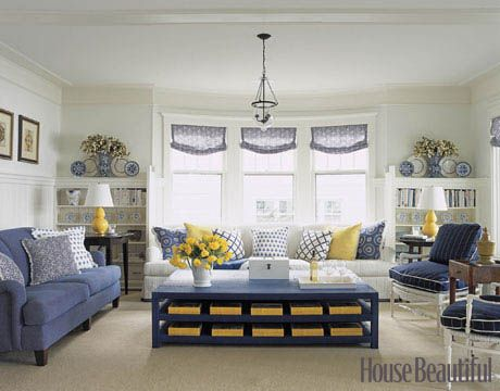 Add pops of yellow to the classic blue-and-white design. Living Room Decorating Ideas. Design by Tom Stringer. housebeautiful.com #color_ideas #coffee_table #sofa #couch