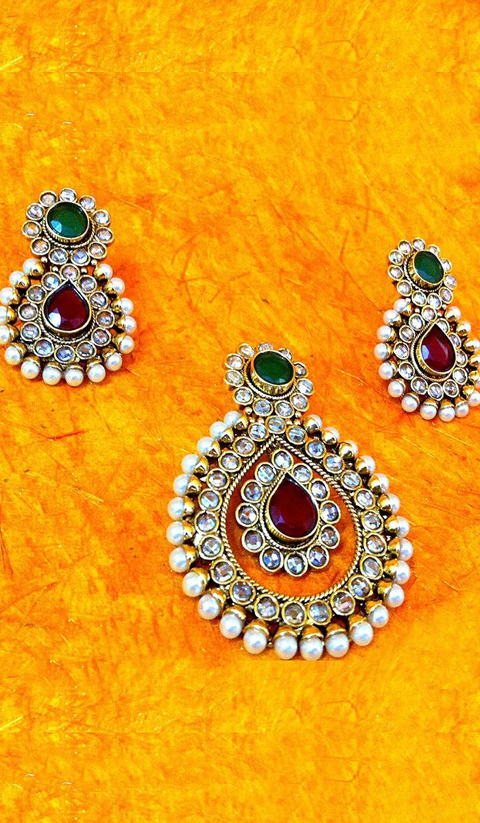 Pendantsets red and green stone studded pendant set with earrings