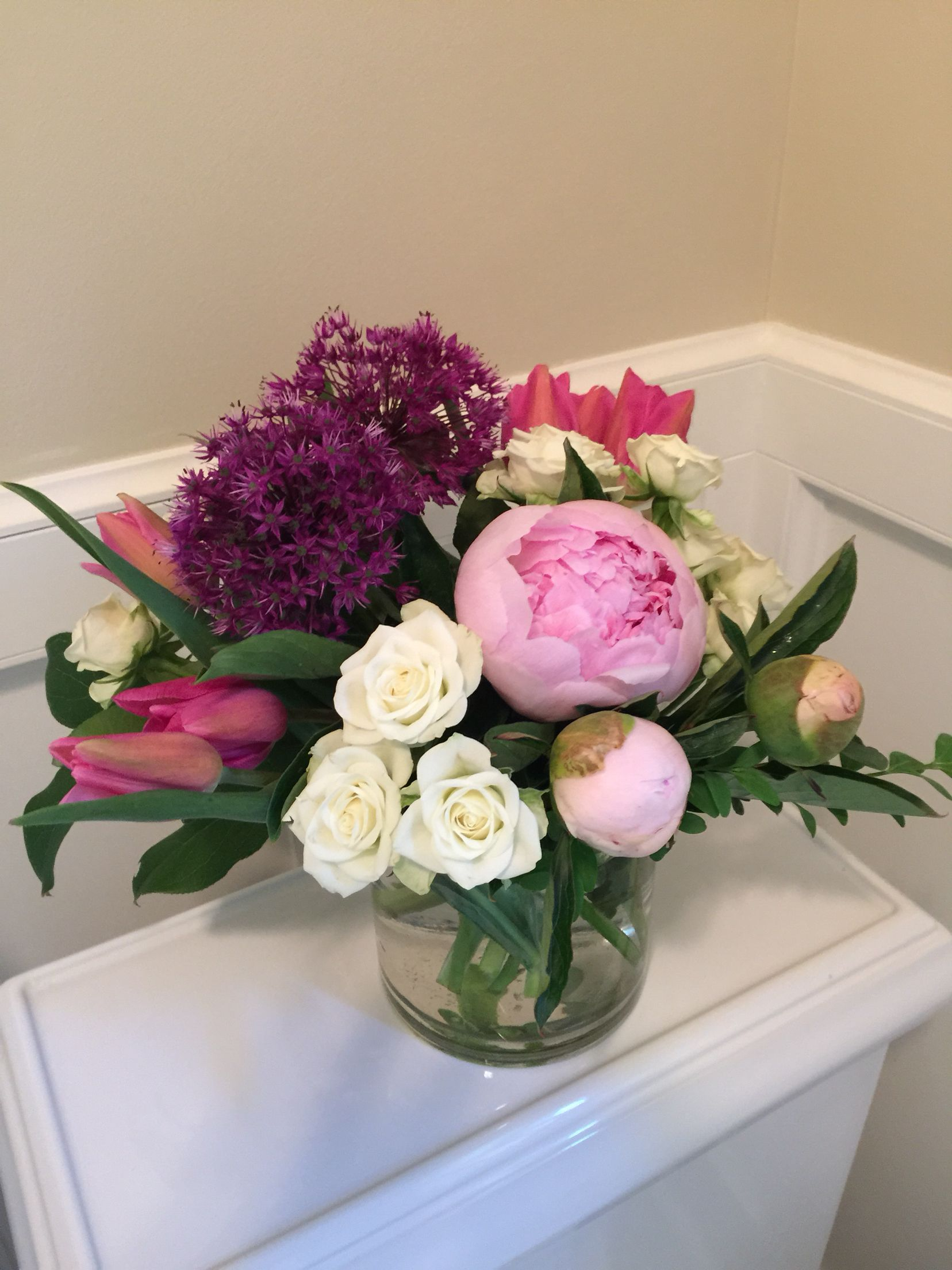 Another view of peonies allium tulips and roses