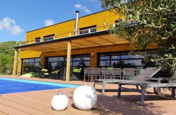 Maison bois à toit plat avec piscine - TempoBois Maison en bois