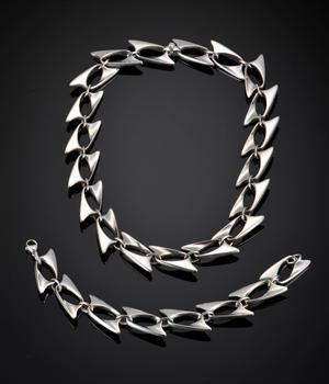 http://www.lauritz.com/en/auction/henning-koppel-for-georg-jensen-silver-necklace-and-bracele/i2065646/