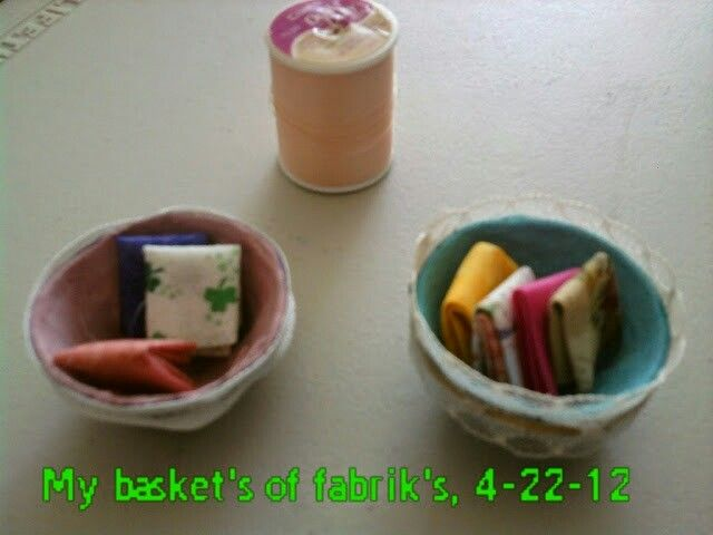 Baskets made for fabrics out of an egg curtain.