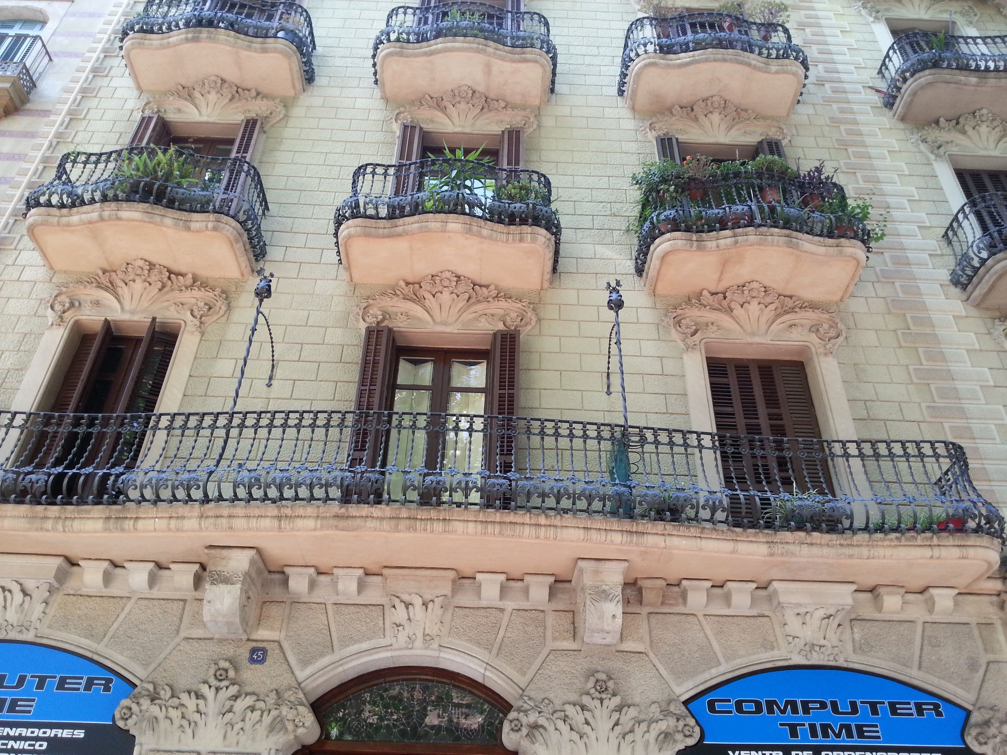 Wrought Iron work and sculpted balconies in Barcelona, Spain.