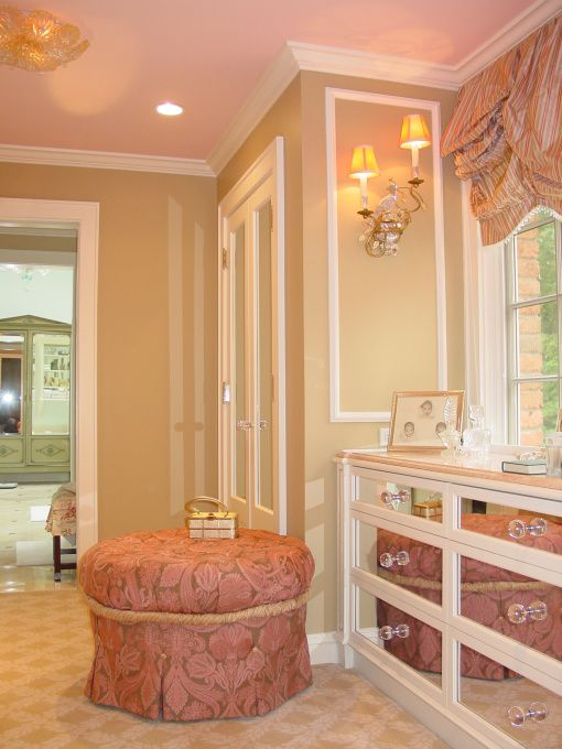 Pretty details - mirrored drawer fronts, window for natural light, sconces