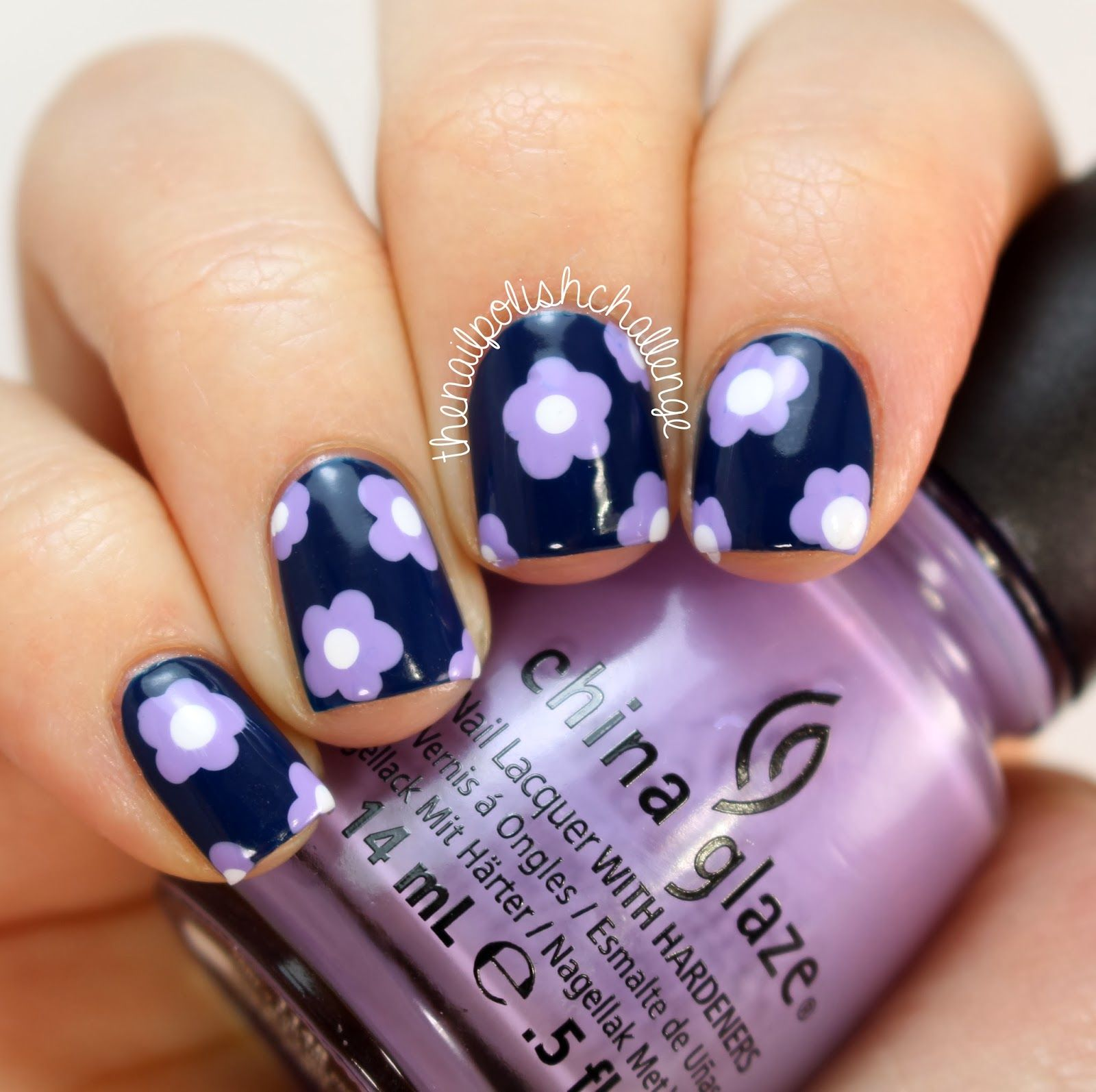 The nail polish challenge simple lavender and navy flower nail art