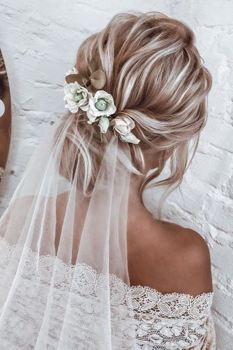 Hot Wedding Hair Trends 2020 wedding hair trends blonde textured low updo with white…