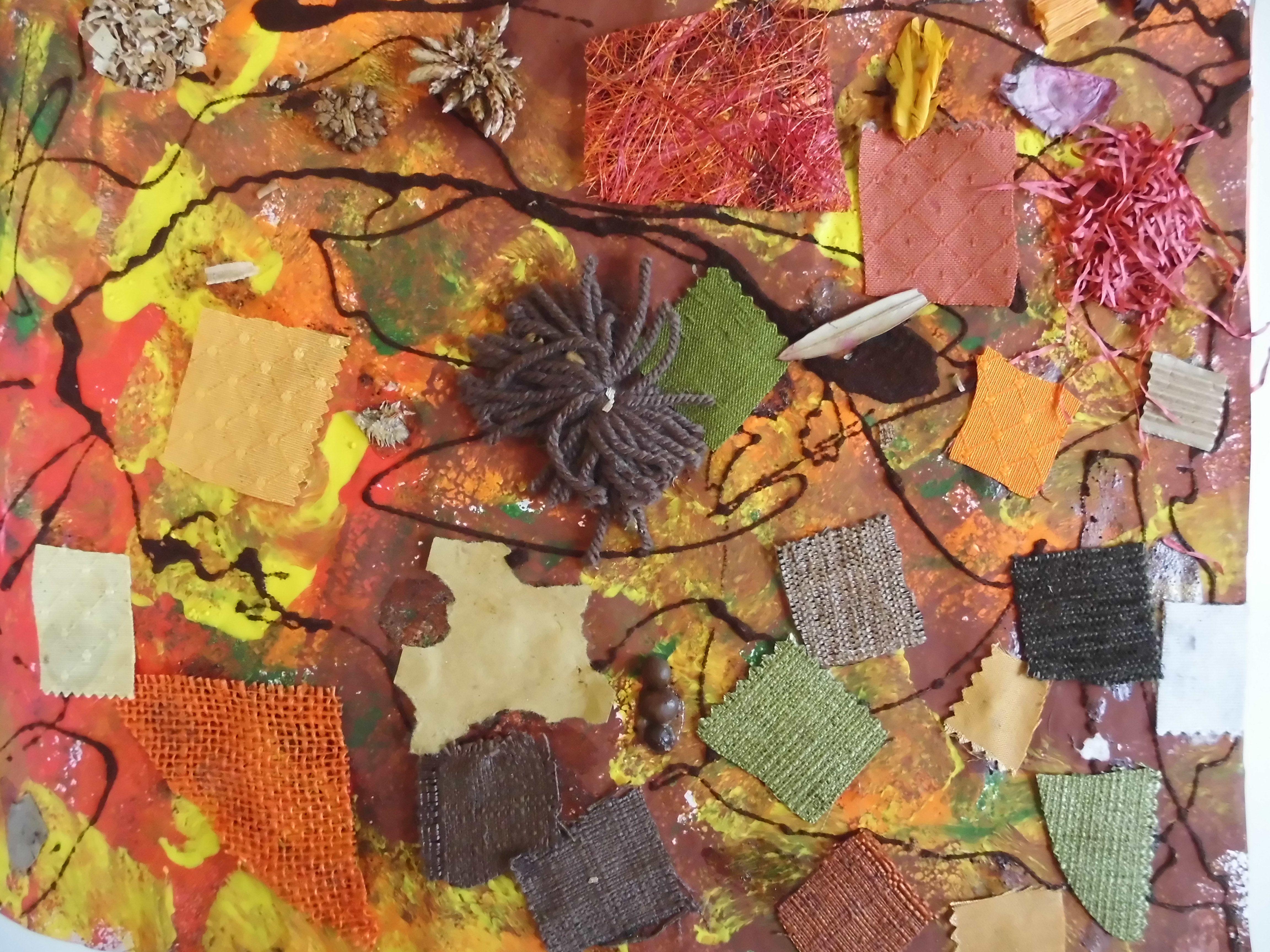 immagine di un collage realizzato da un bimbo i colori sono quelli dell'autunno: verde scuro, marrone, giallo