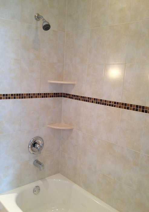 8x12 ceramic shower wall tile installation with a 1x1 glass accent ...
