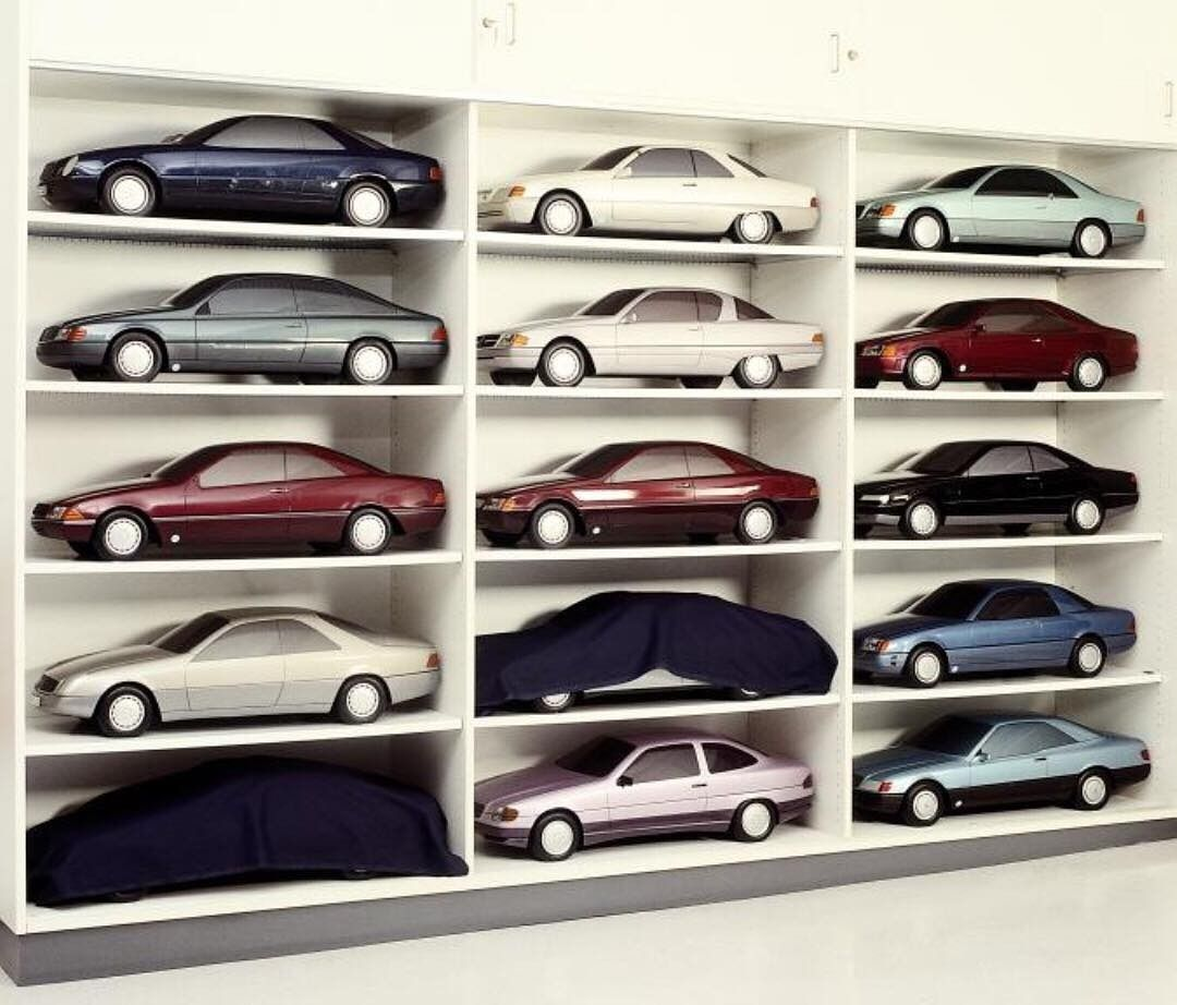 Scale model proposals for the @MercedesBenz CL C140 sit on a shelf in the design studio (c. 1990) #TBT