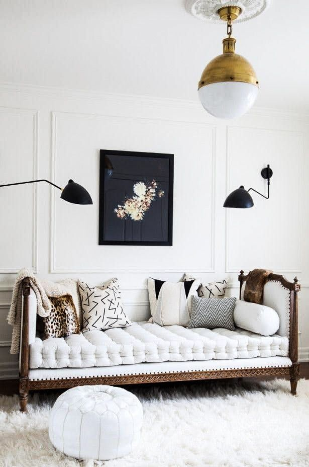 Love the antique gold light fixture paired