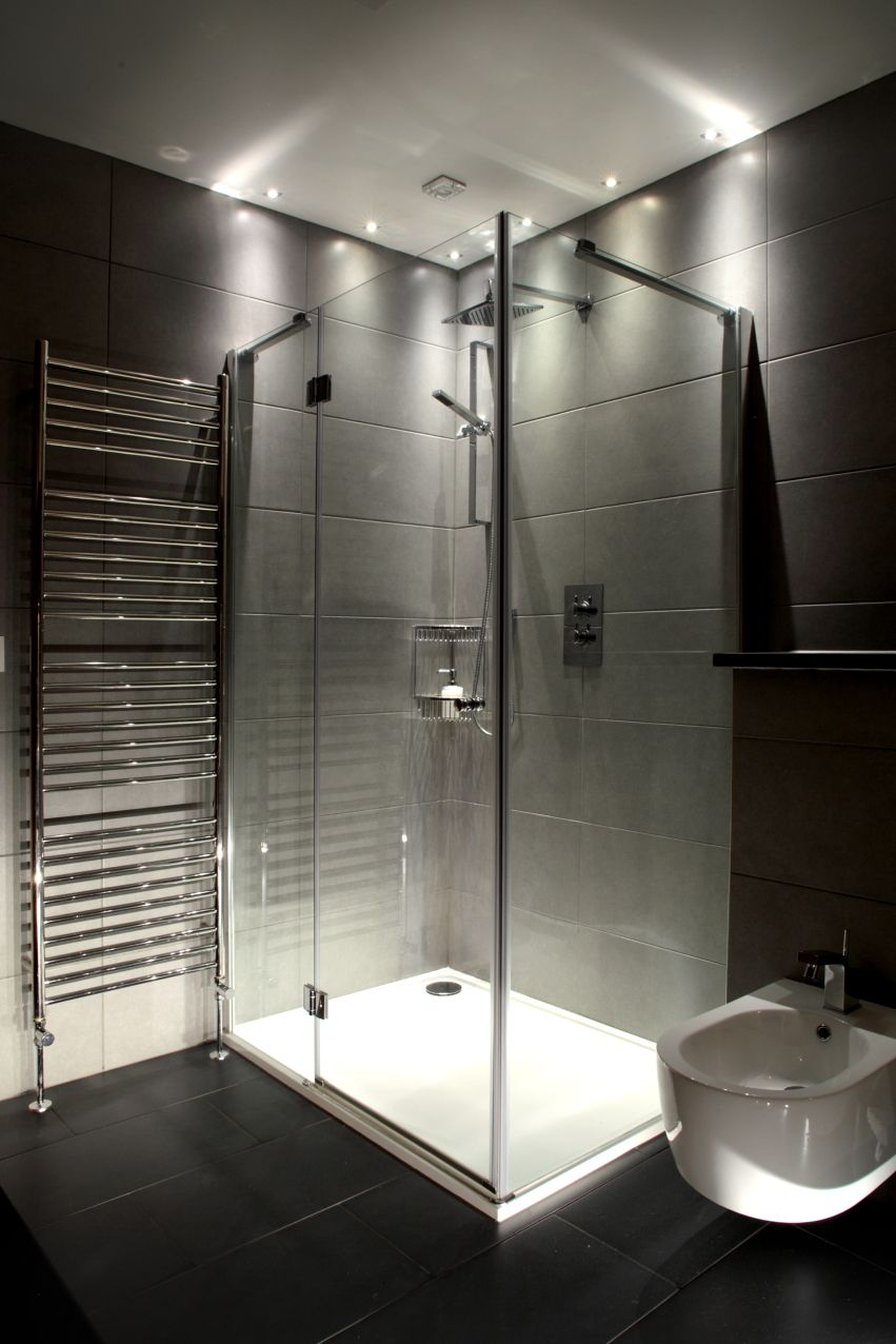 Mini feature glass downlights make a feature of the shower cubicle in this ensuite bathroom
