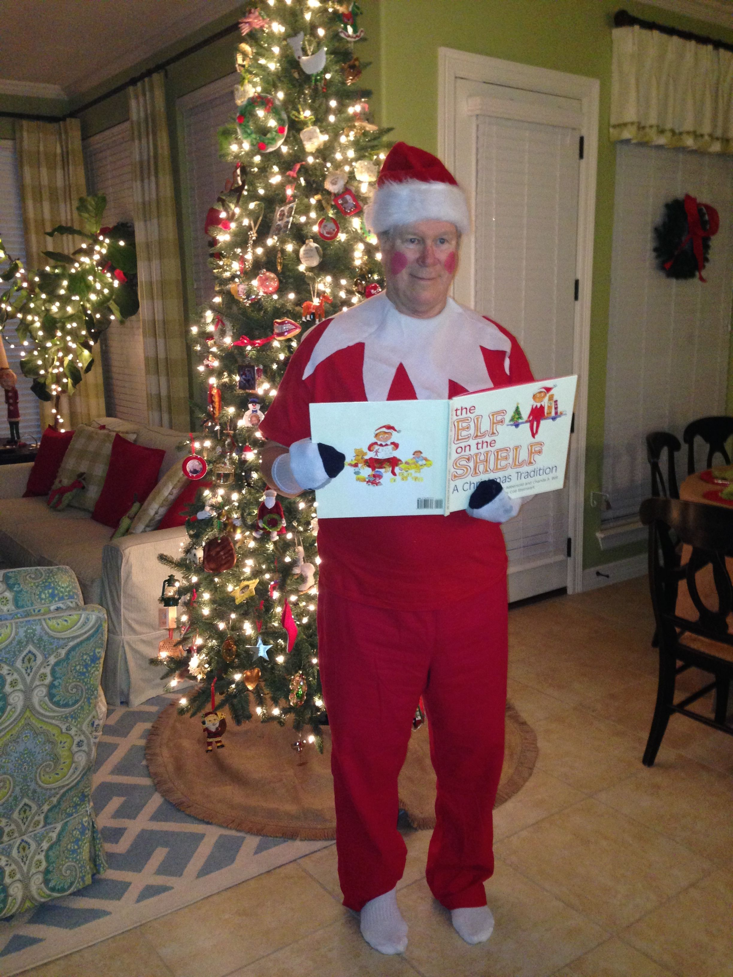 #DomestiKate Grandpa takes Elf on a Shelf to a new level.  Where is Grandpa hiding?   So much fun last Christmas.   Hard not to laugh at dad with socks on his hands and lipstick cheeks.  Funny Christmas Eve game for older kids.