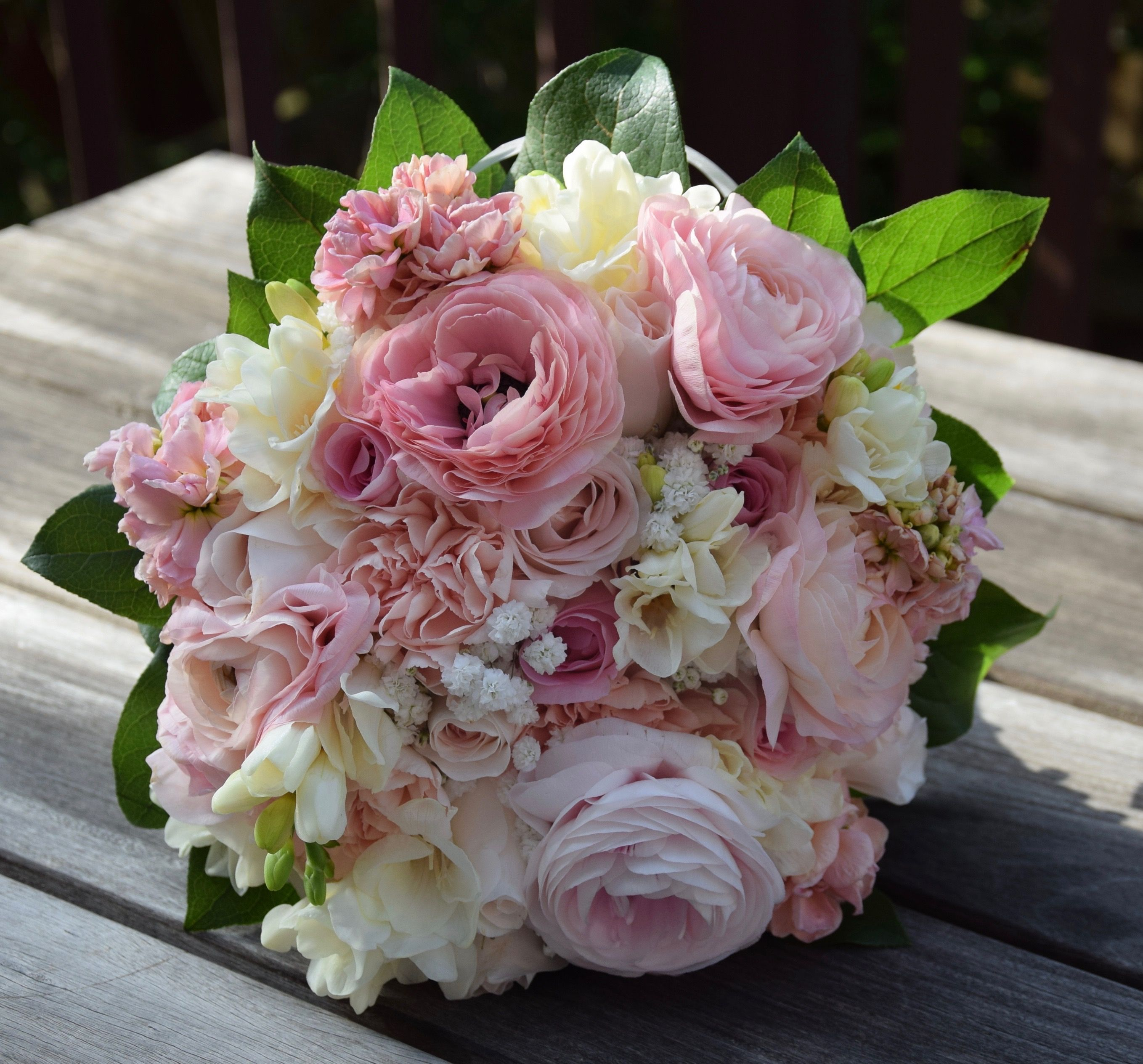 Bridal hand tied bouquet in pastel colors ranunculus for Pastel colored flower arrangements