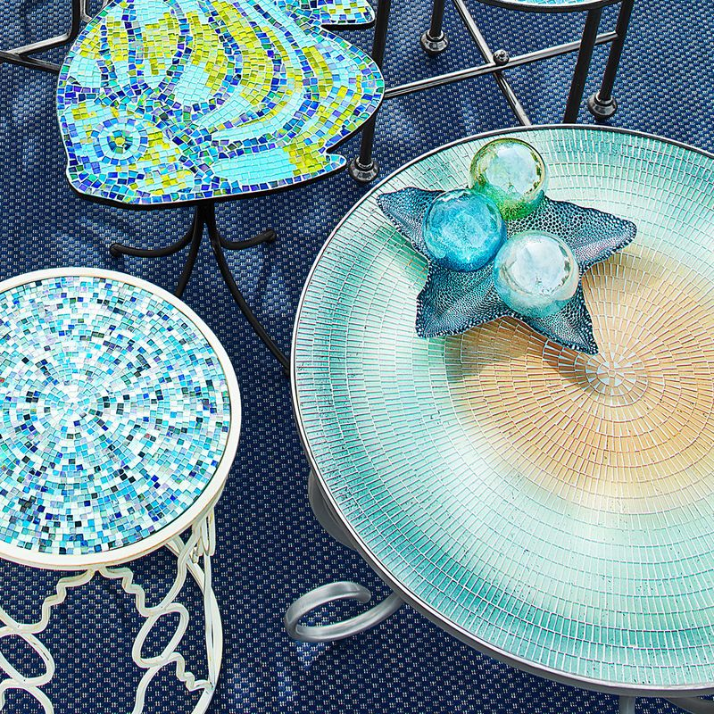 Can't take your eyes off our Alesia design? It's mesmerizing for sure, with ring after ring of glass mosaic tiles in beguiling shades of blue and complemented by a silvery rim and curved legs. It's the perfect spot to enjoy your morning coffee or share drinks by the pool.