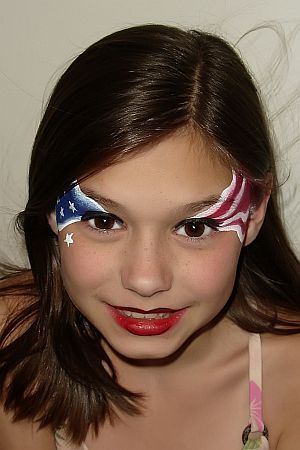 Do blue star on one eye, red and white stripes on opposite side of face, maybe up n dwn