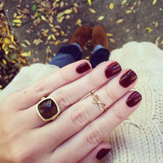 The nail color is perfect for fall and we love the dainty bow ring.