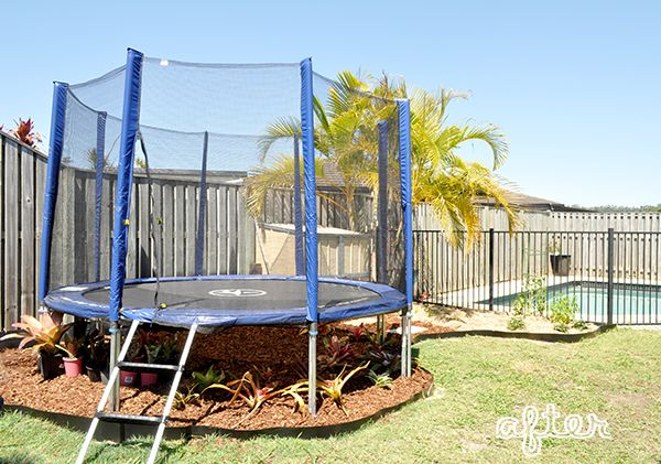 Our Trampoline Garden The Organised Housewife Backyard Trampoline Backyard Small Backyard Landscaping