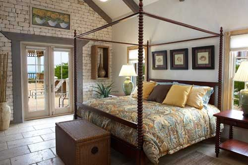 Four poster bed and french doors to patio French patio doors