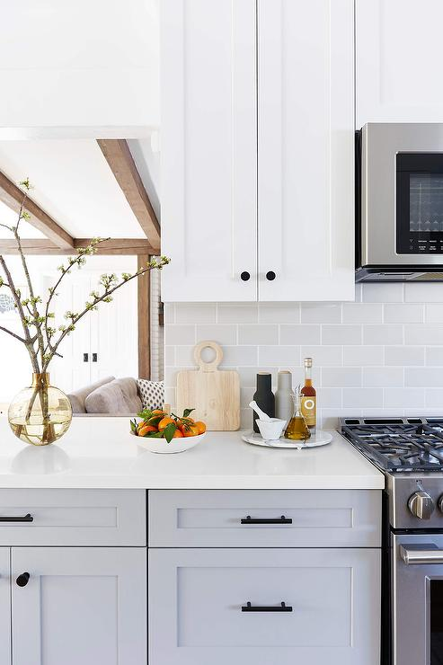 White Upper Cabinets With Light Gray Subway Tiles Transitional Kitchen Upper Kitchen Cabinets Light Grey Kitchen Cabinets Light Grey Kitchens
