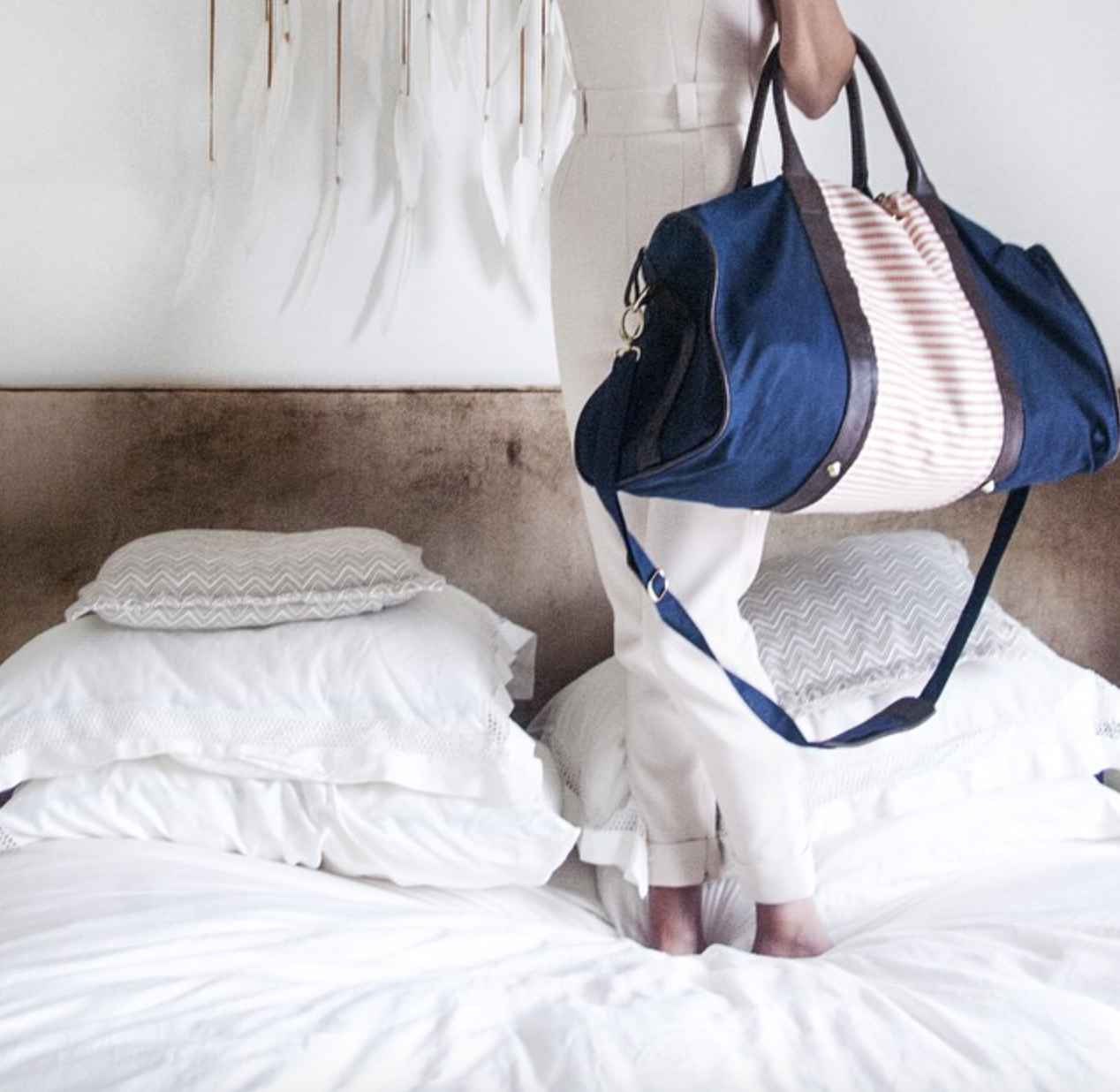 Travel Instructions: Zip on your Miscere appliqué, check into your favorite hotel & jump on the bed upon arrival.  #miscere #nevertoooldtojumponbeds #travelchic #interchangeable #musexcarly #weekenderbag