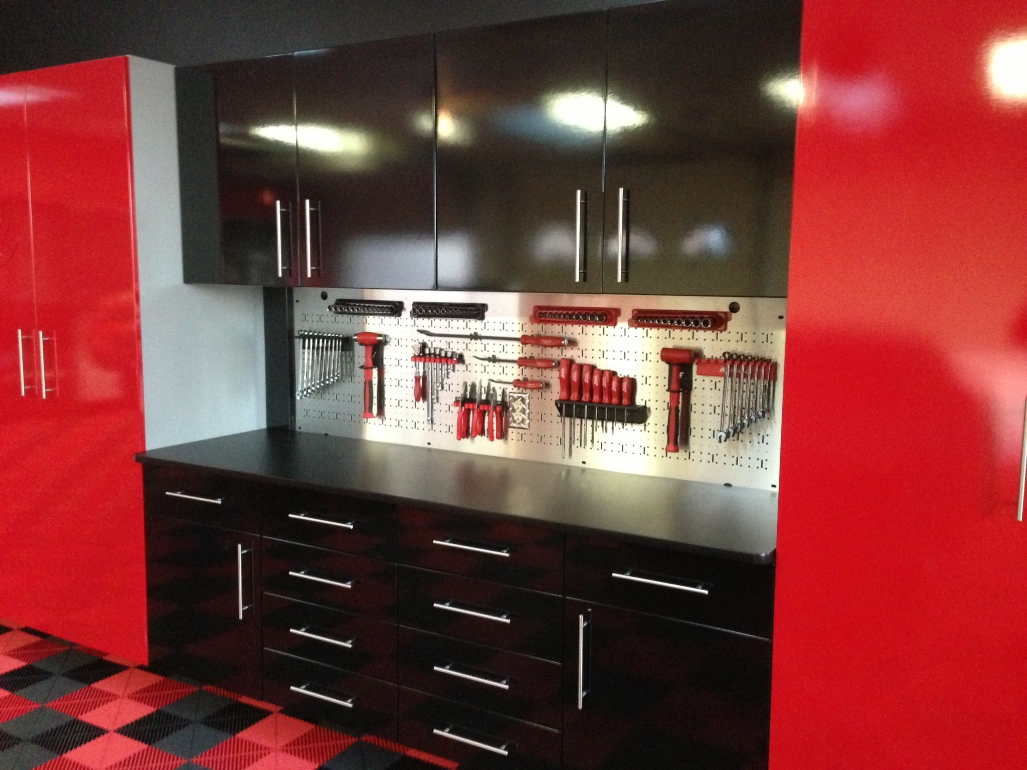 This Homeowner Used Our High Gloss Finish For Their Garage Cabinets Swisstrax Flooring Was Used To Finish The Look Modern Flooring Garage Cabinets Homeowner